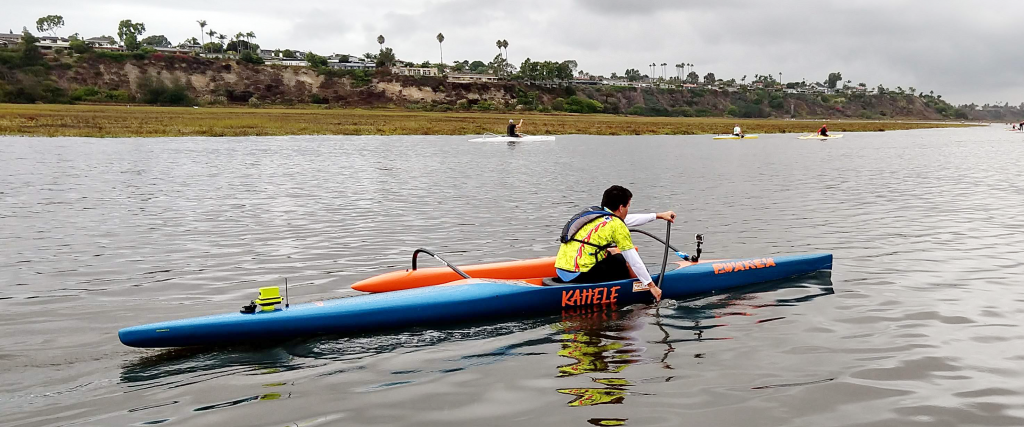 A Makapo paddler in a one-person outrigger canoe (OC1) with the final version of CoOP attached.